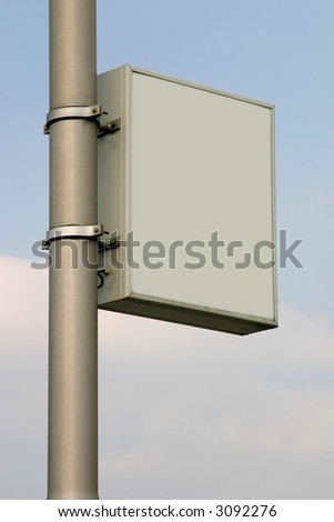 Empty sign against clouded sky. Add your own text. - stock photo