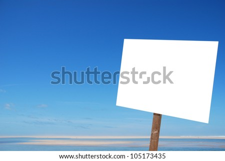 empty sign at the beach isolated on white (blue sky background, copy-space available for design)