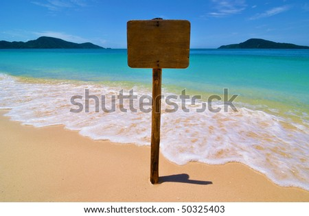 Empty sign on a tropical beach [insert text] - stock photo