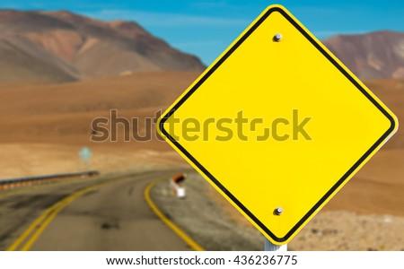 Empty sign on desert road - stock photo