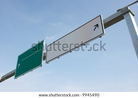 Empty signboards of a highway exit. Add your own text - stock photo