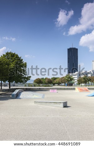 Empty skate park at the Vienna Danube Island - one of the most interesting extensive public recreation area with the new DC-Tower - the tallest skyscraper in Austria. - stock photo