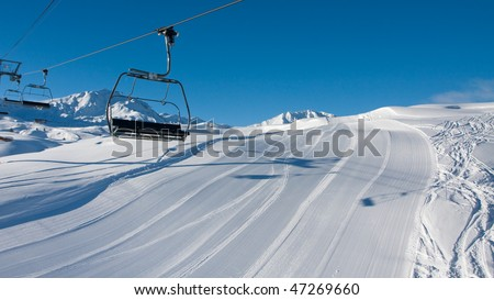 Empty skiing slope and chairlift. Early morning - stock photo