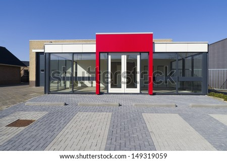 empty small office building with red entrance - stock photo