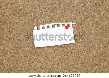 Empty Small White Paper on Cork Bulletin Board - stock photo