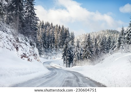 Empty snow covered road - stock photo