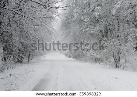 Empty snow covered road in winter landscape, Winter Driving - Winter Road - stock photo