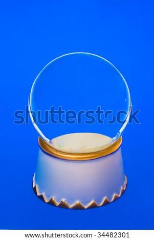 empty snow globe on blue - stock photo
