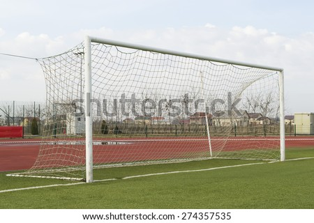 Empty soccer or football gate on a sports training facility, side view - stock photo
