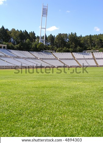 empty soccer stadium - view from the pitch - stock photo
