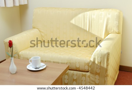 Empty sofa and a cup of coffee
