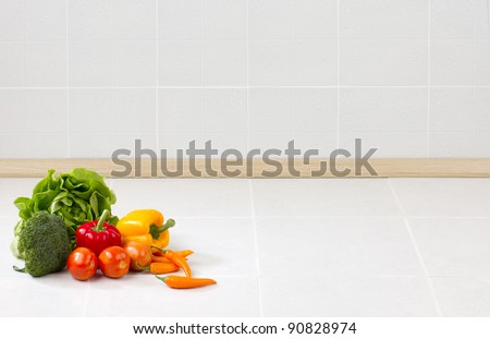 Empty space on the counter in the kitchen with vegetables for putting text or your product on it - stock photo