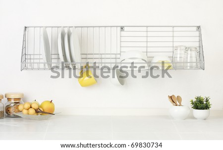 Empty space on the shelf and on the  kitchen table top that you could put your stuffs or ideas into it - stock photo