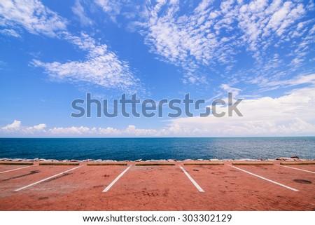 Empty space parking lot on the sea coast - stock photo