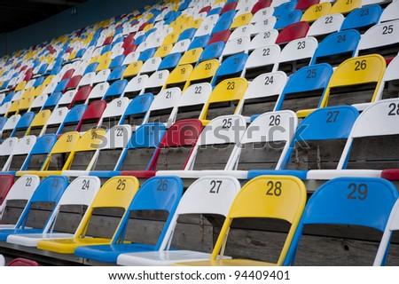 Empty sports stadium seating area - stock photo