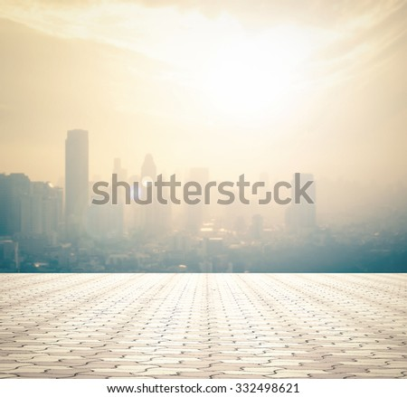 Empty square and floor blurred aerial view of Bangkok skyline on amazing beauty golden light sunrise. Beautiful hotel, resident of Bangkok, Thailand, Asia. Abstract blur big city background concept. - stock photo