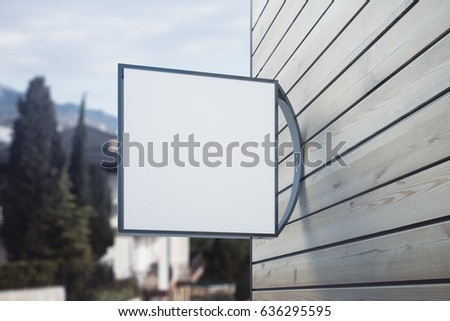 Empty square poster on wooden building. Landscape background. Pub/bar/cafe/shop concept. Close up, Mock up, 3D Rendering