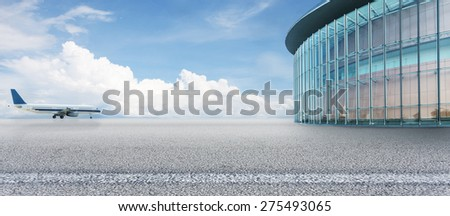 Empty square with airplane and modern building as background - stock photo