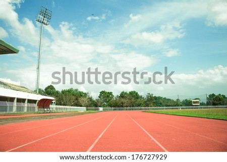 empty stadium arena and race running track treadmill background - stock photo