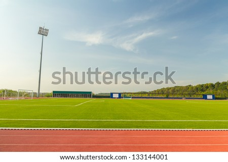 Empty Stadium Arena With Football Field And Racing Tracks - stock photo