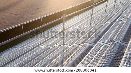 Empty stadium bleachers - stock photo