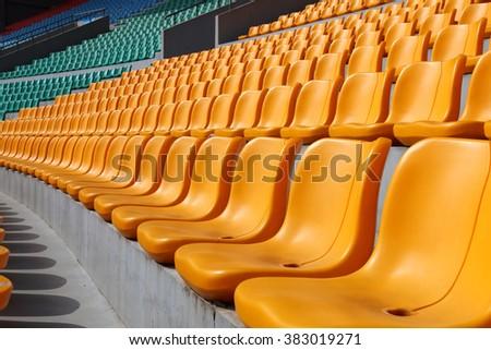 Empty stadium seats awaiting the spectators - stock photo