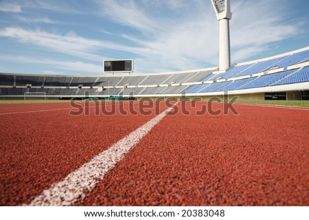Empty stadium with grandstand and running track - stock photo