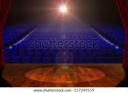Empty Stage and Empty Seats with Bright Spotlight - stock photo