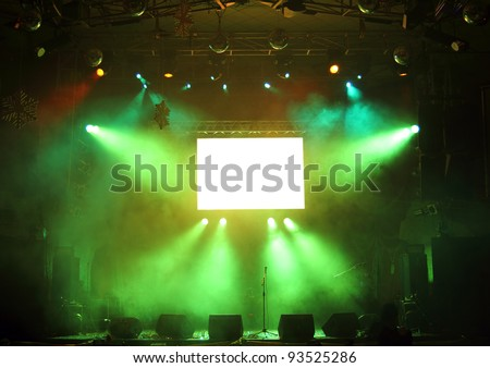 empty stage and screen in the rays of light concert - stock photo
