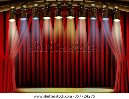 Empty stage with red curtain and spot lights - stock photo