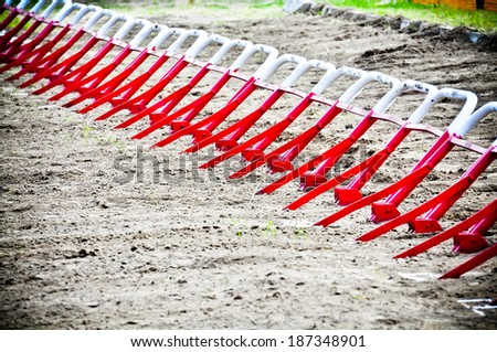 empty starting gates before start at motocross ride - stock photo