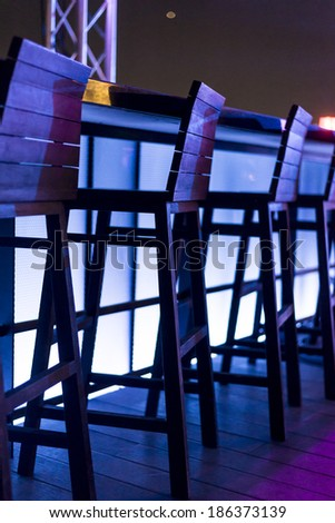 empty stools in nightclub - stock photo