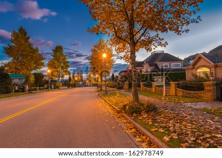 Empty street at at night, disk, sunset, sunrise time in suburbs of Vancouver, Canada. - stock photo