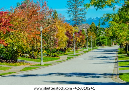 Empty street in a nice and comfortable neighborhood. Vancouver, Canada. - stock photo