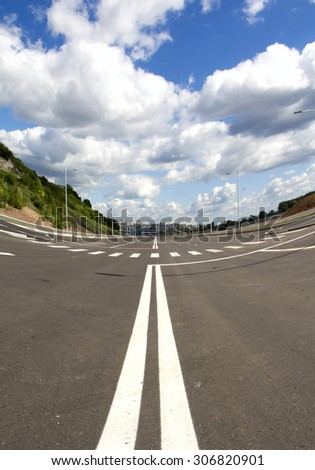 Empty street in big city. Blue sky and white cloud. Vertical composition. Wide angle - stock photo