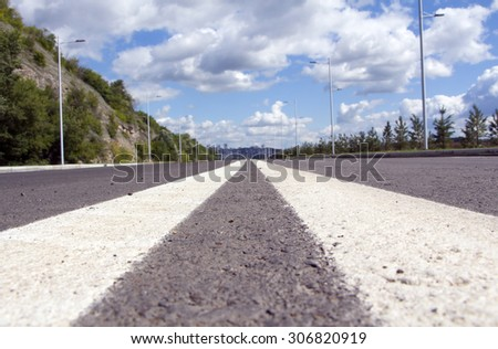 Empty street in big town. Blue sky and white cloud - stock photo