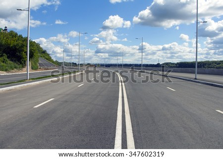 Empty street in big town. Blue sky and white cloud. Ufa city - stock photo