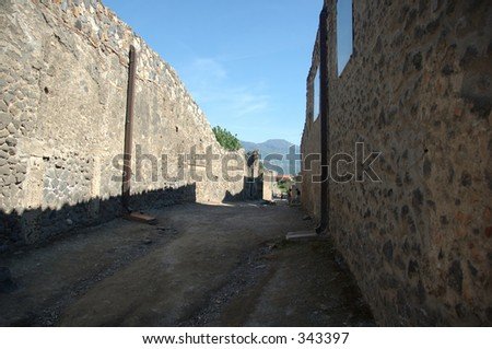 empty street in Pompeii, Italy. Town destroyed by volcano 2000 years ago. - stock photo