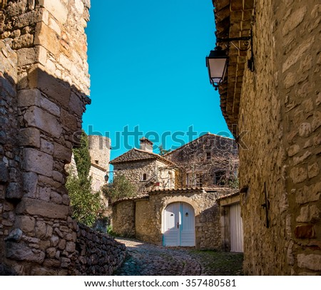 Empty street of La Roque-sur-Ceze, it is very picturesque village on a rocky peak in southern France. This place classified as one of the most beautiful villages in France - stock photo