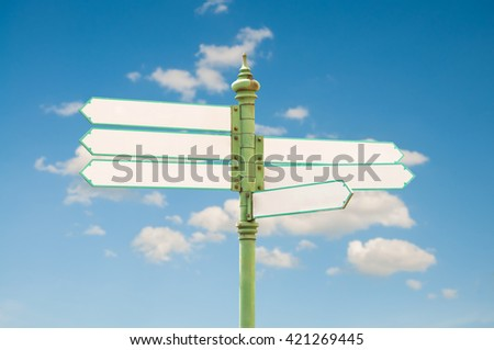 Empty street sign with sky and clouds
