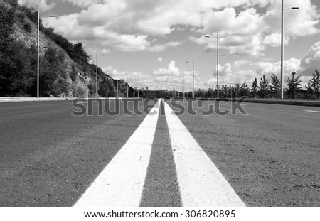 Empty street to big city. Black and white photo - stock photo