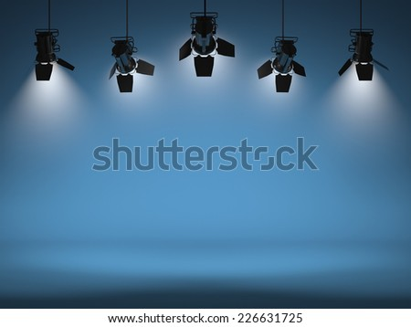 Empty studio with headlights on - stock photo