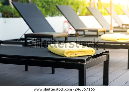 empty sunbed with wrapped towels. - stock photo