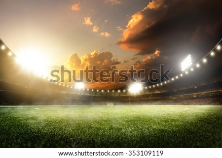 Empty sunset grand soccer arena in the lights - stock photo