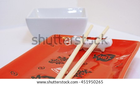 Empty sushi table. Ready for dunner. On white background.