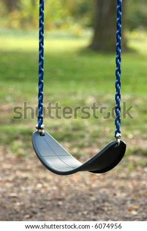 Empty Swing - stock photo