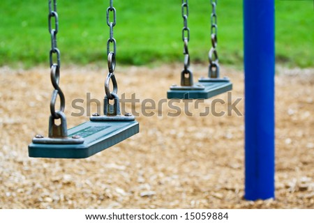 Empty swing in a parc in quebec - stock photo