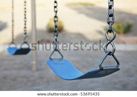 Empty swing set - stock photo