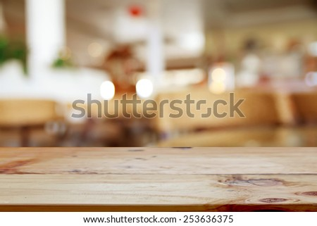 Empty table and blurred bokeh background - stock photo