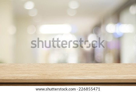 Empty table and blurred store with bokeh background, product display template. - stock photo